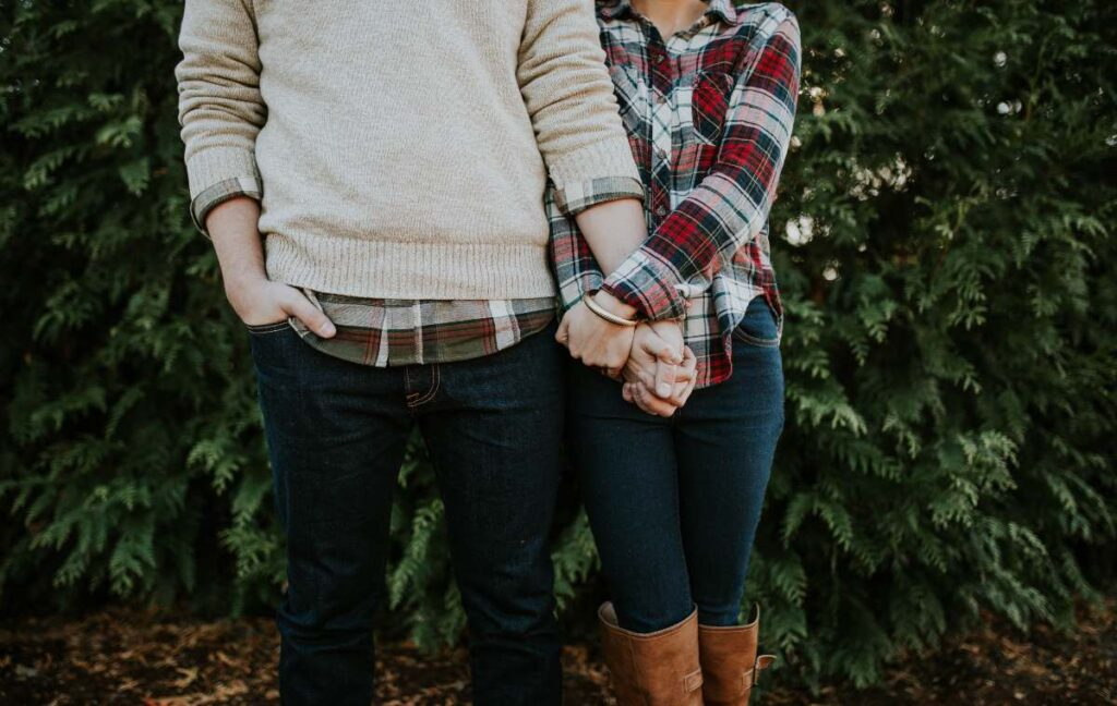 Couple standing and holding their hands together-love at first sight quotes