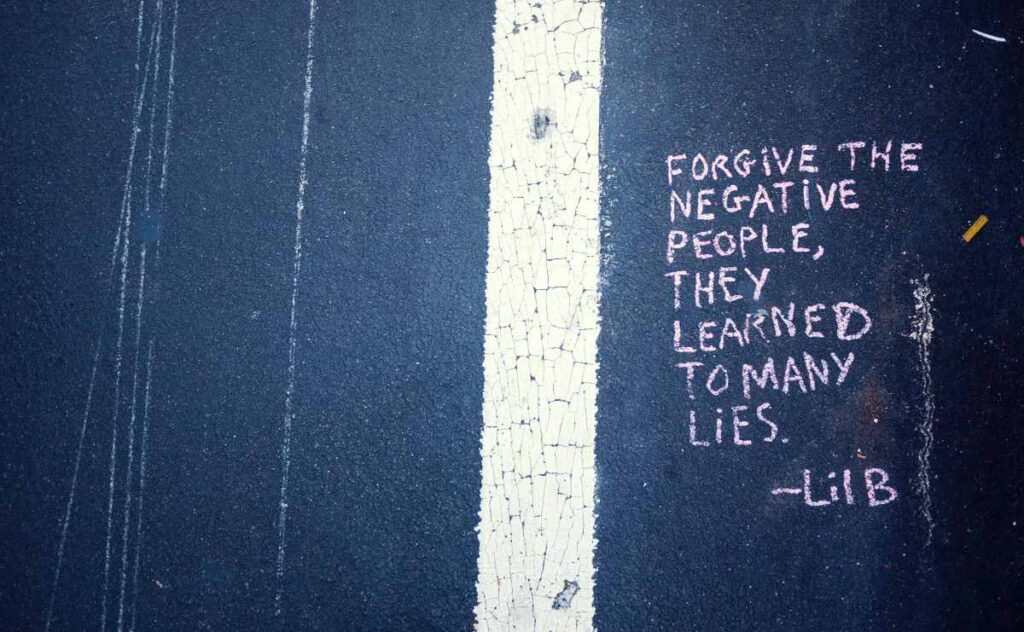 Quote written on a road about forgiveness - apology quotes