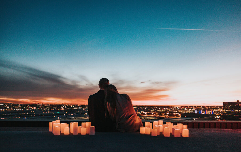Couple hugging each other on a romantic evening - how long does it take to fall in love