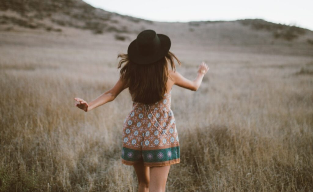 Girl running through the grass - independent women quotes